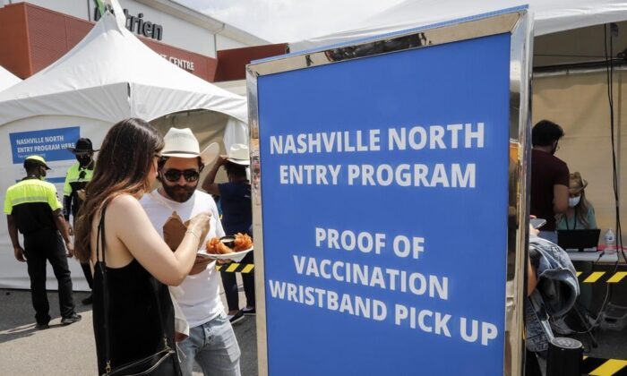 Visitors to Nashville North are shown at the Calgary Stampede in Calgary, on July 9, 2021. (The Canadian Press/Jeff McIntosh)
