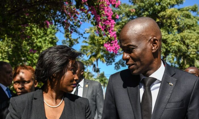 The late president of Haiti Jovenel Moise (R) arrives with the first lady Martine Moise (L) for the official ceremony of Haiti's 10th earthquake anniversary in Port-au-Prince, on Jan. 12, 2020. (Photo by Chandan Khann/AFP)