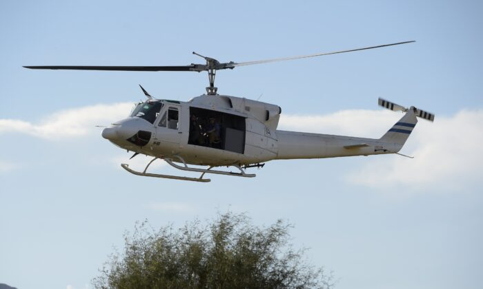 A Bell 212 helicopter in a file photo. (Juan Mabromata/AFP via Getty Images)