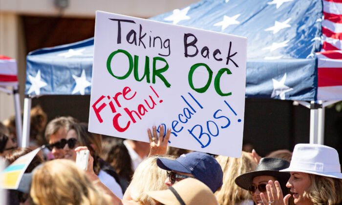 People gather in protest in front of the Orange County Hall of Administration in Santa Ana, Calif., on May 25, 2021. (John Fredricks/The Epoch Times)
