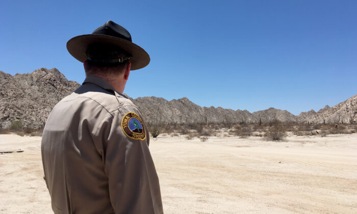 Sheriff Leon Wilmot in the desert east of Yuma, Ariz., near the U.S.-Mexico border on May 25, 2018. (Charlotte Cuthbertson/The Epoch Times)