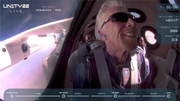 Branson smiles on board Virgin Galactic's passenger rocket plane