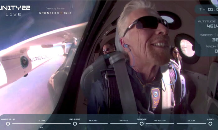 In a still image from video, Billionaire Richard Branson smiles on board Virgin Galactic's passenger rocket plane VSS Unity before starting its untethered ascent to the edge of space above Spaceport America near Truth or Consequences, N.M., on July 11, 2021.    (Virgin Galactic/Handout via Reuters)