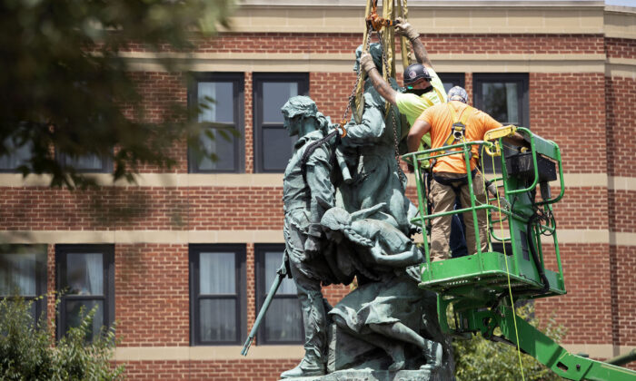 The statue of Meriwether Lewis, William Clark, and Sacagawea is removed from Charlottesville, Va., on July 10, 2021. (Ryan M. Kelly/AFP via Getty Images)
