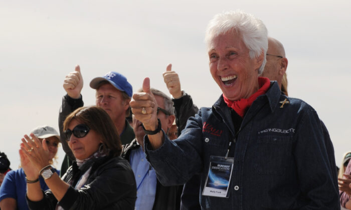 Wally Funk (R) celebrates before the Virgin Galactic VSS Enterprise spacecraft makes it's first public landing during the Spaceport America runway dedication ceremony near Las Cruces, N.M., on Oct. 22, 2010. (Mark Ralston/AFP via Getty Images)