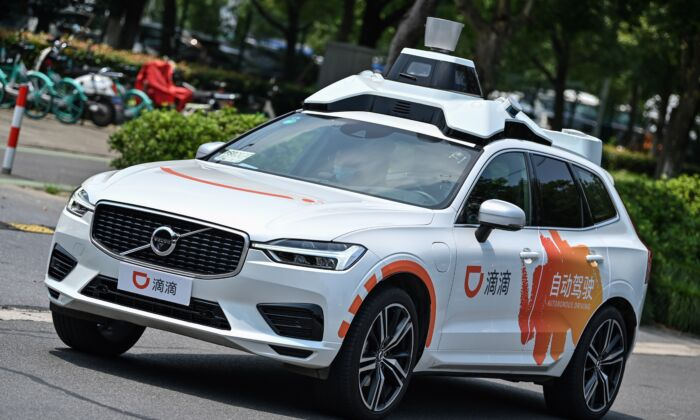 A Didi autonomous taxi is performing a pilot test drive on the streets in Shanghai on July 22, 2020. (Hector Retamal/AFP via Getty Images)