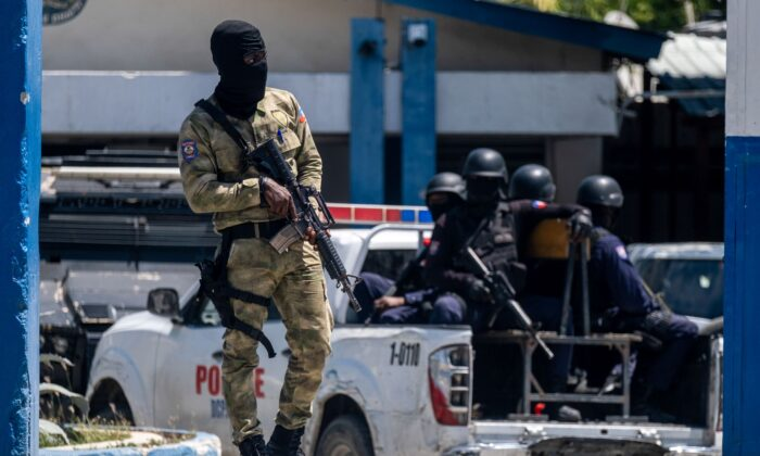 An armed Haitian Army troop guards the entrance of the General Directorate of the police where the suspects of the assassination of Haiti's President Jovenel Moise are detained, in Port-au-Prince, Haiti on July 10, 2021. (Ricardo Arduengo/Reuters)
