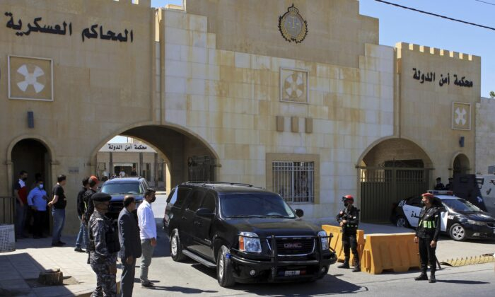 Bassem Awadallah, a former royal adviser, leaves a state security court in a vehicle after the first session of his closed-door trial, in Amman, Jordan, on June 21, 2021. (Raad Adayleh/AP Photo, File)