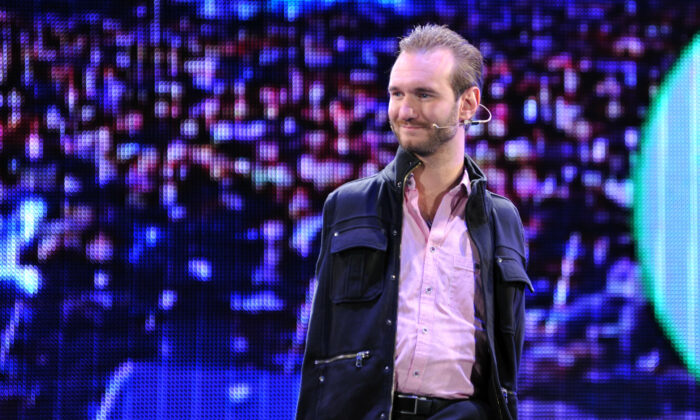 Australian motivational speaker Nick Vujicic delivers a speech to 50,000 spectators at the Taipei World Trade Center Nangang Exhibition Hall on Dec. 14, 2013. (Mandy Cheng/AFP via Getty Images)