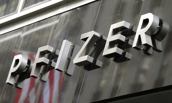 A sign for Pfizer is displayed in New York in a file photo. (Timothy A. Clary/AFP via Getty Images)