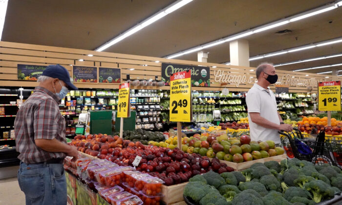 Customers shop for produce at a supermarket in Chicago on June 10, 2021. (Scott Olson/Getty Images)