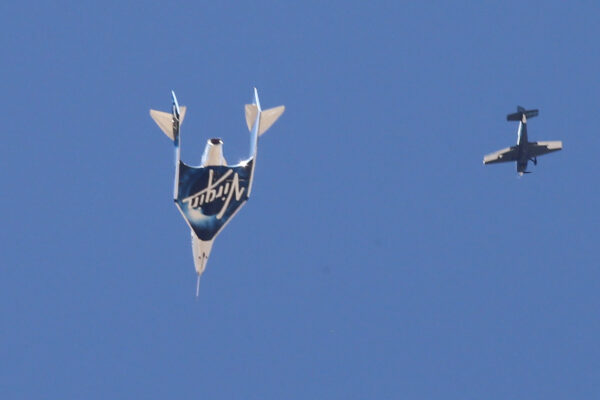 Virgin Galactic's passenger rocket plane VSS Unity descends after reaching the edge of space above Spaceport America