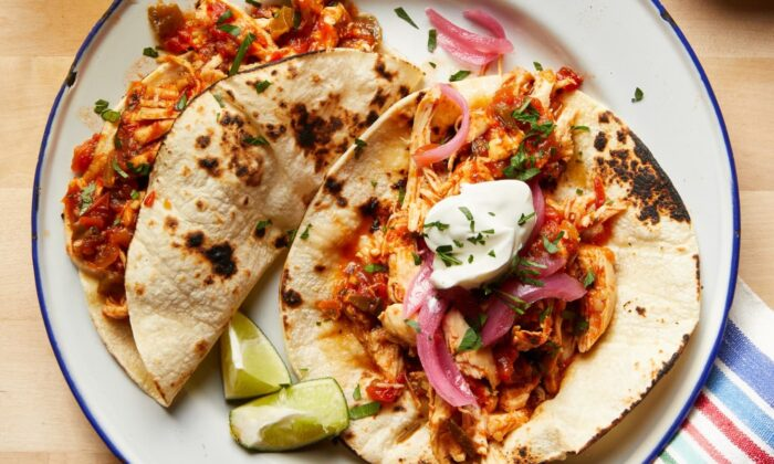 This two-ingredient shredded chicken is ready for tacos, burritos, grain bowls, sandwiches, and salads. (Tara Donne/TNS)
