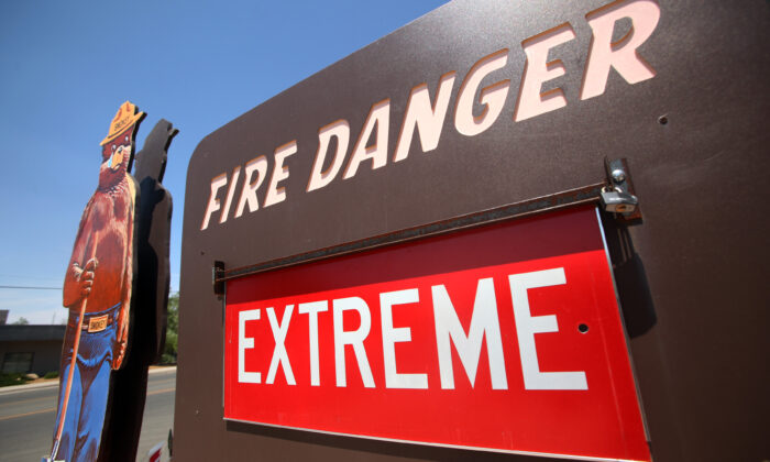 An extreme fire danger sign is pictured outside of the Prescott Fire Station 1 in Prescott, Ariz., on July 2, 2013. (Krista Kennell/AFP via Getty Images)