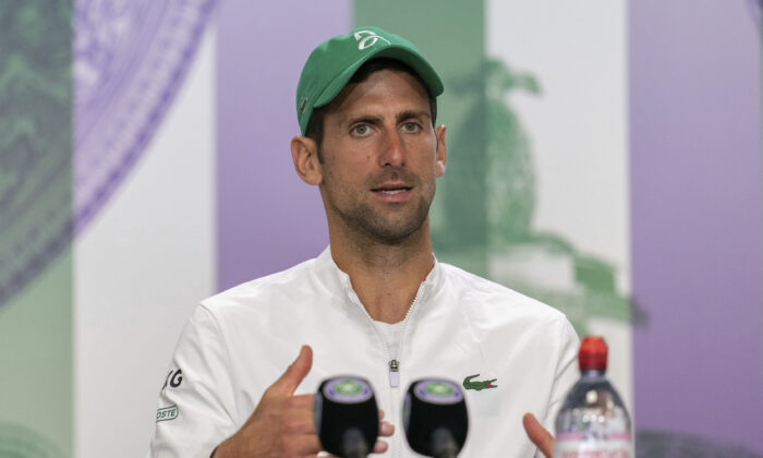 Novak Djokovic attends a press conference after winning the men's final against Italy's Matteo Berrettini at the Wimbledon Tennis Championships in London, on July 11, 2021. (Joe Toth/Pool via AP)