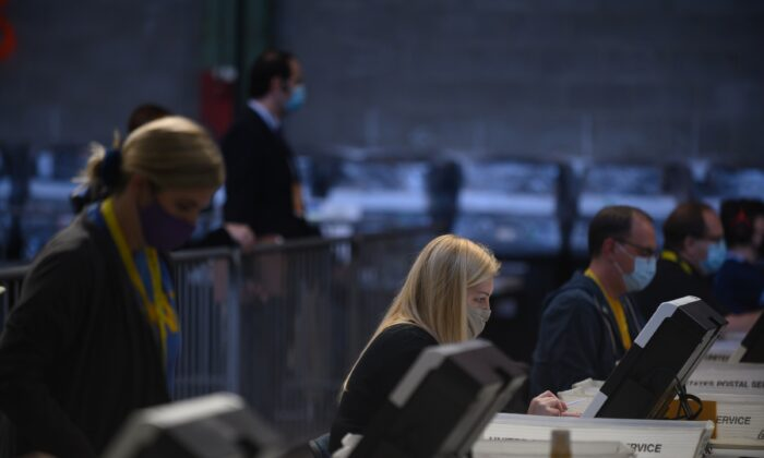 Election officials count ballots at the Allegheny County elections warehouse in Pittsburgh, Penn., on Nov. 6, 2020. (Jeff Swensen/Getty Images)