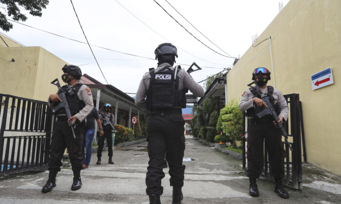 Police officers stand guard at a local police hospital where the bodies of militants killed during a raid were taken to, in Palu, Central Sulawesi, Indonesia, on July 11, 2021. (Josua Marunduh/AP Photo)