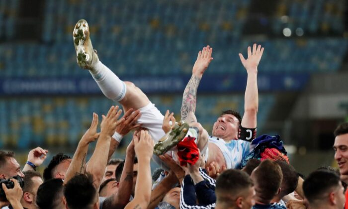 Teammates lift Argentina's Lionel Messi after beating Brazil 1-0 in the Copa America final soccer match at the Maracana stadium in Rio de Janeiro, Brazil, on July 10, 2021. (Bruna Prado/AP Photo)