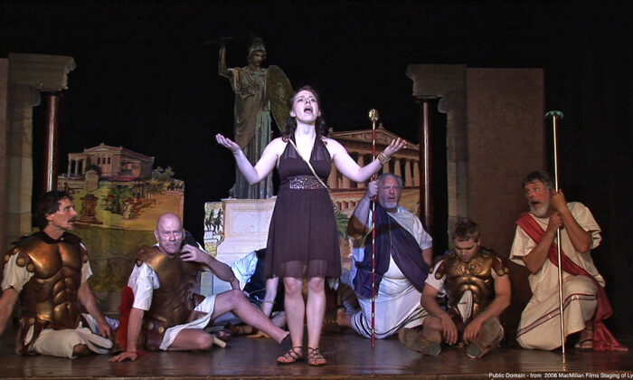 """Probably the most famous ancient Greek play satirizes the dynamics between men and women. At the play's end, Lysistrata negotiates peace and the end of the Peloponnesian War in a scene fromMacmillan Films 2008 Staging of Aristophanes's """"Lysistrata,"""" directed by James Thomas in New York. (Public Domain)"""