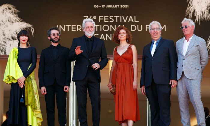 Director Ari Folman and cast members Karen O and Lena Guberman with composer Ben Goldwasser, producer Jani Thiltges, and a guest pose on the 74th Cannes Film Festival, in Cannes, France, on July 9, 2021. (Johanna Geron/Reuters)