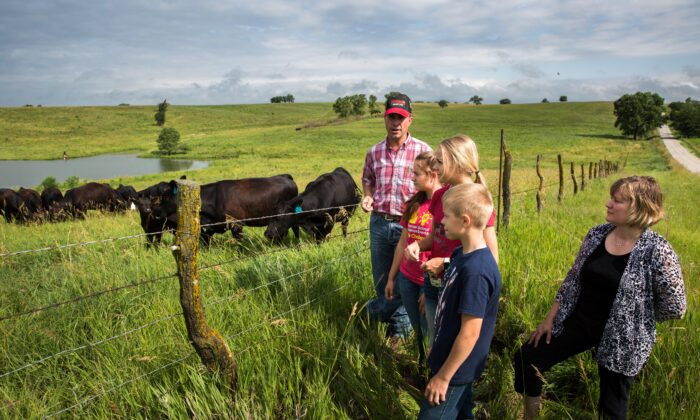 Cattle farmer Rod Christen (L) with family at his farm in southern Nebraska on June 25, 2021. (Petr Svab/The Epoch Times)