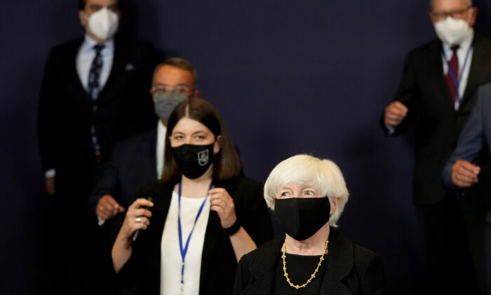 U.S. Treasury Secretary Janet Yellen (C) poses for a group photo of eurogroup finance ministers at the European Council building in Brussels on July 12, 2021. (Virginia Mayo/AP)