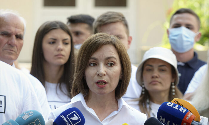Moldova's President Maia Sandu speaks to the media after casting her vote in a snap parliamentary election, in Chisinau, Moldova, on July 11, 2021. (Aurel Obreja/AP Photo)