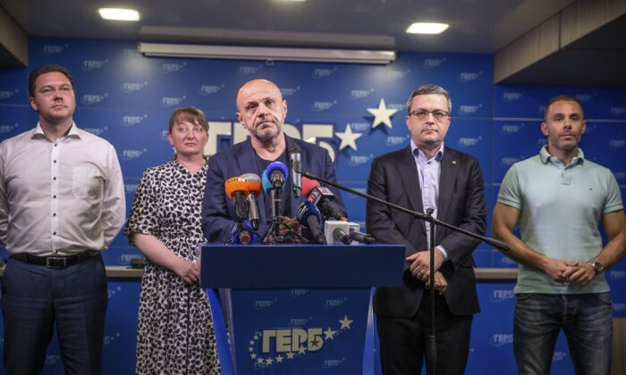 Former Deputy Prime Minister Tomislav Donchev (C) and GERB political party officials attend a news conference in capital Sofia, Bulgaria, on July 11, 2021. (Visar Kryeziu/AP Photo)