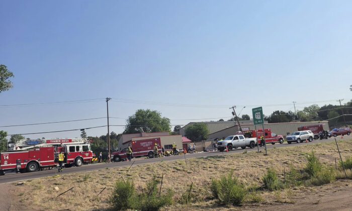 Timber Mesa Fire and Medical District emergency personnel gather at the scene of a mass casualty incident near Downtown 9 in Show Low, Ariz., on June 19, 2021. (Timber Mesa Fire and Medical District/File via AP)