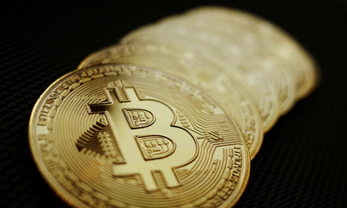 Representations of the Bitcoin cryptocurrency are seen in this illustration picture taken on June 7, 2021. (Edgar Su/Reuters)