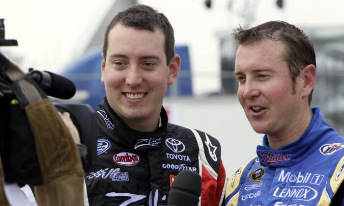 Drivers Kyle Busch (L) and Kurt Busch (R) speak to reporters during practice for a NASCAR Sprint Cup Series auto race in Darlington, S.C., on May 7, 2010. (Gerry Broome/AP Photo)