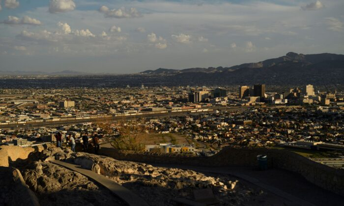 People look towards the downtown El Paso and the US-Mexico border in El Paso, Texas, on June 24, 2021. (PATRICK T. FALLON/AFP via Getty Images)