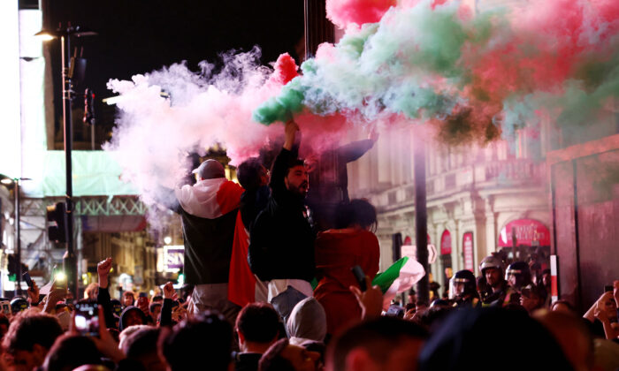 Italy fans celebrate after winning the Euro 2020 in London on July 12, 2021. (Henry Nicholls/Reuters)