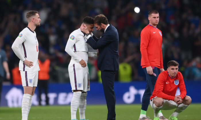 Gareth Southgate, Head Coach of England consoles Jadon Sancho following defeat in the UEFA Euro 2020 Championship Final between Italy and England at Wembley Stadium, London on July 11, 2021. (Laurence Griffiths/Getty Images)