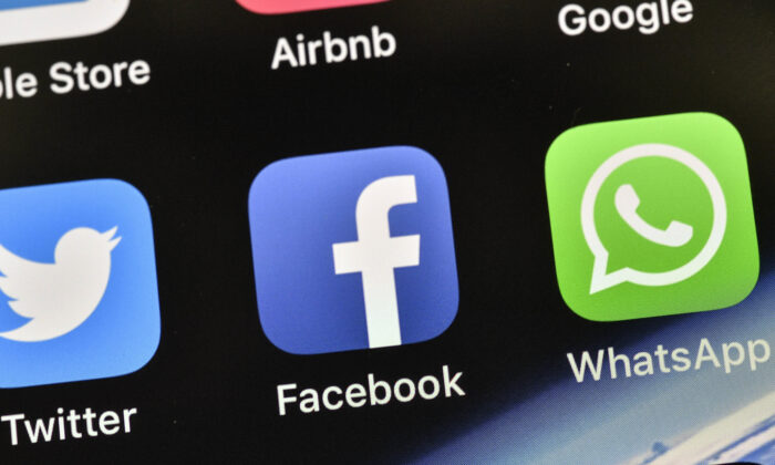 The icons of Facebook and WhatsApp are pictured on an iPhone, in Gelsenkirchen, Germany, on Nov. 15, 2018. (Martin Meissner/AP Photo)