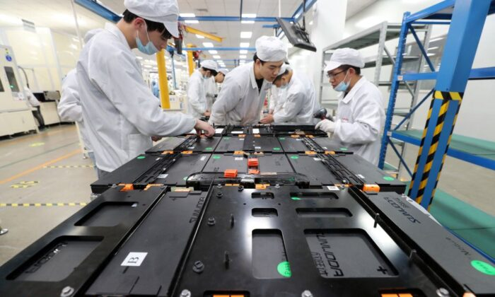 Workers at a factory for Xinwangda Electric Vehicle Battery Co. Ltd,  which makes lithium batteries for electric cars and other uses, in Nanjing in China's eastern Jiangsu province. (STR/AFP via Getty Images)