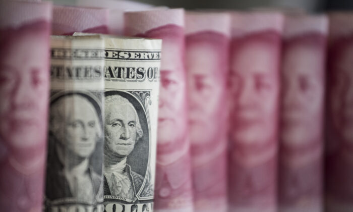 Chinese 100 yuan notes and U.S. one dollar notes in Beijing on Jan. 6, 2017. (Fred Dufour/AFP via Getty Images)