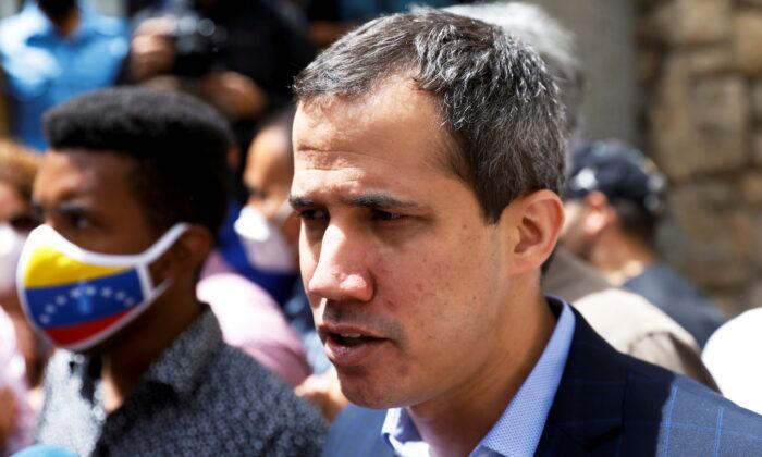 Venezuela's opposition leader Juan Guaido speaks to the media, in Caracas, Venezuela, on July 12, 2021. (Leonardo Fernandez Viloria/Reuters)