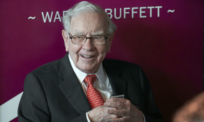 Warren Buffett, Chairman and CEO of Berkshire Hathaway, smiles as he plays bridge following the annual Berkshire Hathaway shareholders meeting in Omaha, Neb., on May 5, 2019. (Nati Harnik/AP Photo)