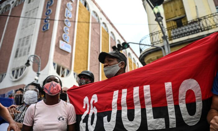People take part in a demonstration against the communist regime of Cuban President Miguel Diaz-Canel in Havana, on July 11, 2021. (Yamil Lage/AFP via Getty Images)