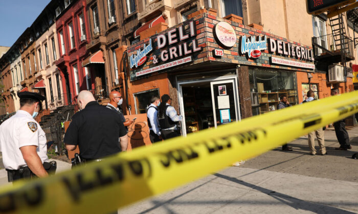 Police stand at the scene of a shooting that happened in the Bedford Stuyvesant neighborhood in Brooklyn on July 16, 2020 in New York City. (Spencer Platt/Getty Images)