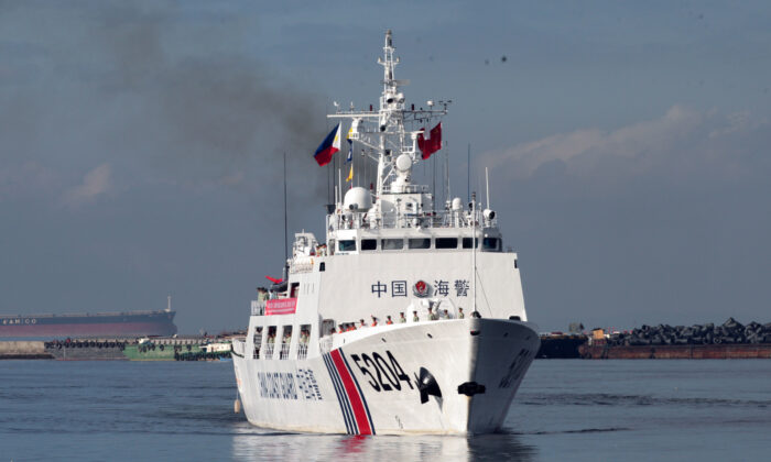 A Chinese Coast Guard ship prepares to anchor at Manila port for a port call on Jan. 14, 2020. (AFP via Getty Images)
