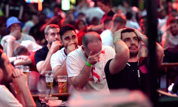 England fans at Boxpark Croydon as Italy's Leonardo Bonucci scores their side's first goal, in London on July 11, 2021. (Ashley Western/PA)