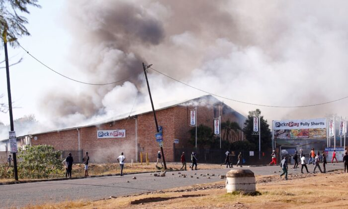 A supermarket burns as protests continue in Pietermaritzburg, South Africa, on July 12, 2021. (Rogan Ward/Reuters)
