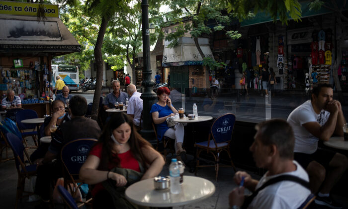 People sit in a cafe in central Athens, Greece, on Sept. 3, 2020. (Alkis Konstantinidis/Reuters)