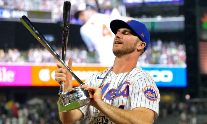 National League's Pete Alonso, of the New York Mets, holds the champions trophy after winning the MLB All Star baseball Home Run Derby in Denver on Monday, July 12, 2021. (David Zalubowski/AP Photo)