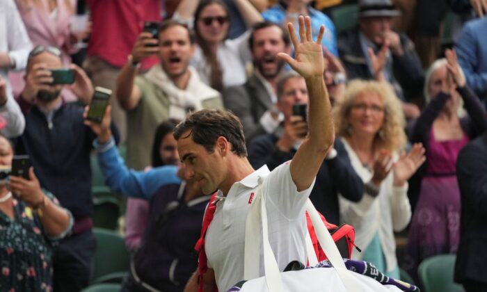 Switzerland's Roger Federer leaves the court on day nine of the Wimbledon Tennis Championships in London, on July 7, 2021. (Alberto Pezzali/AP Photo)