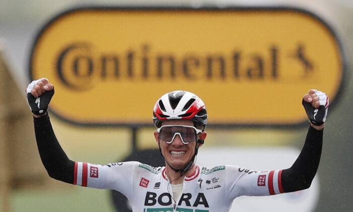 Bora–Hansgrohe rider Patrick Konrad of Austria celebrates as he crosses the finish line to win stage 16 of Tour de France, from Pas de la Case to Saint-Gaudens, in France, on July 13, 2021. (Stephane Mahe/Reuters)
