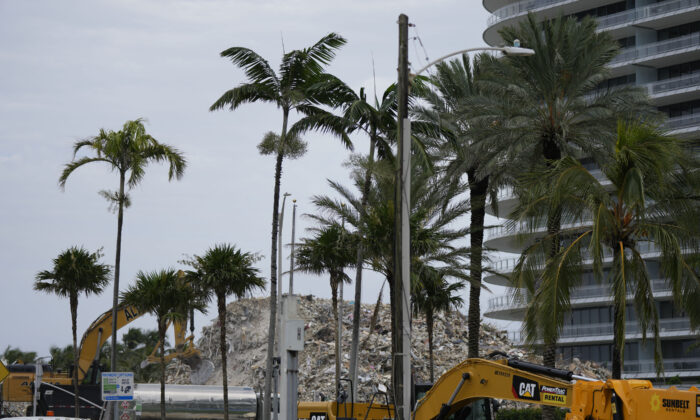 Crews work to clear the rubble of the demolished section of the Champlain Towers South building in Surfside, Fla., on July 12, 2021. (Rebecca Blackwell/AP Photo)