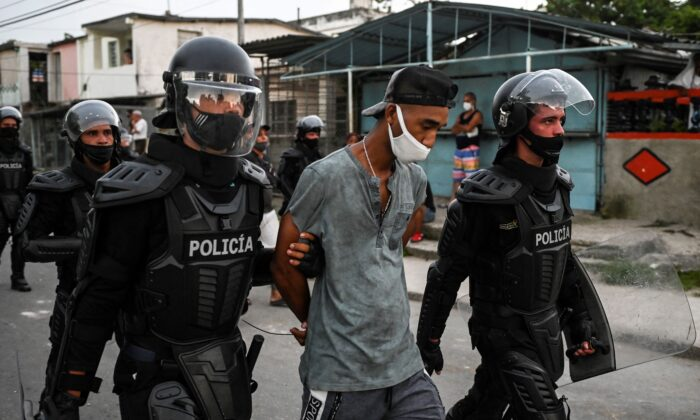 A man is arrested during a demonstration against the government of Cuban leader Miguel Diaz-Canel in Arroyo Naranjo Municipality in Havana, Cuba, on July 12, 2021. (Yamil Lage/AFP via Getty Images)